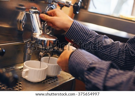Making coffee with a coffee machine. - stock photo