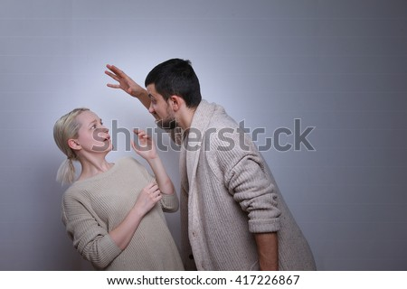 Man brandishing his wife. Husband and wife arguing, man and woman screaming. Family quarrel  - stock photo