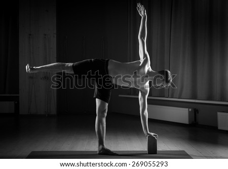 man doing yoga in the gym, black and white - stock photo