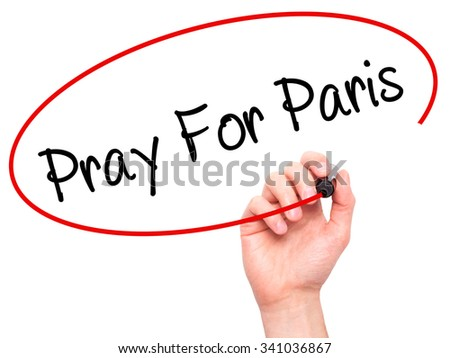Man Hand Pray for Paris with marker on visual screen. Isolated on white.  - stock photo