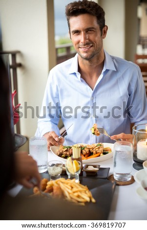 man in love on dinner with his girlfriend, concept romantic dinner  - stock photo