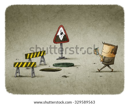 man looking at smartphone and walking to manhole - stock photo