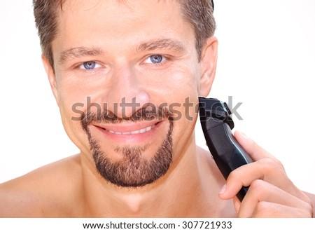 man shaving in bathroom - stock photo