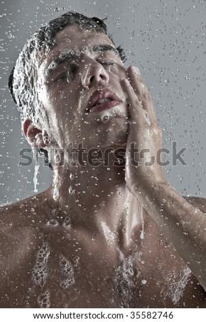 man under the shower - stock photo