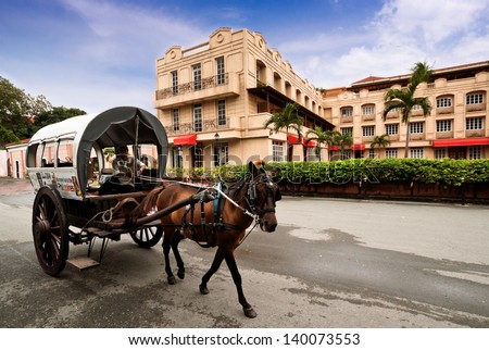 MANILA,PHILIPPINE -MAY2:A horse drawn carriage the most popular forms of transportation in Intramuros on May 2,2012  Manila Philippines. Intramuros is the oldest district and historic core of Manila. - stock photo