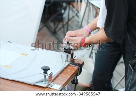 manual screen printing shirt - stock photo