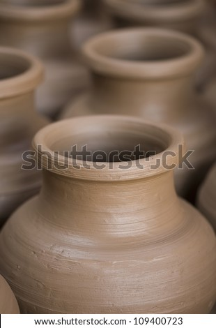 Many earthen pots kept for drying - stock photo