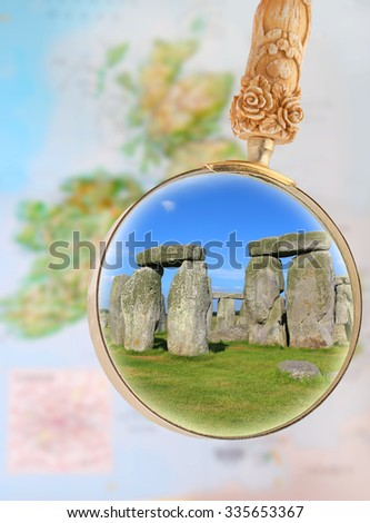 Map of Europe with magnifying glass looking in on Stonehenge, Wiltshire, United, Kingdom - stock photo