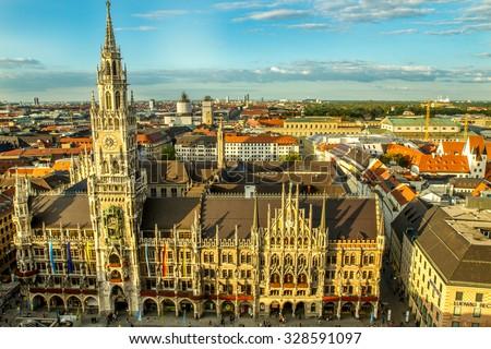 Marienplatz, New Town Hall (Neues Rathaus), Glockenspiel, Frauenkirche with sky in Munich, (Bavaria, Germany) - stock photo