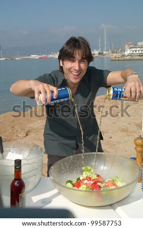 12MAY2000:  Australian actor NICK GIANNOPOULOS at the Cannes Film Festival where he created a Greek salad on the beach to promote his movie The Wog Boy.  Paul Smith / Featureflash - stock photo