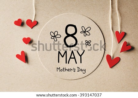 8 May Mothers Day message with handmade small paper hearts - stock photo