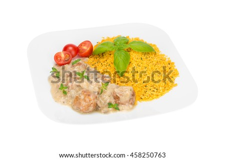 meatballs with buckwheat cous cous in mushroom sauce isolated on the white background - stock photo