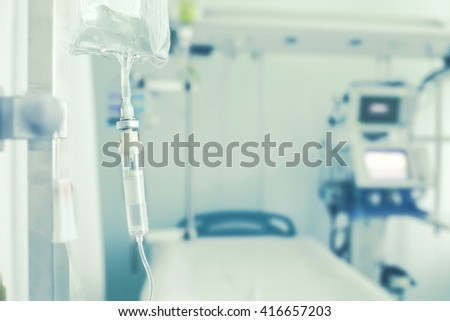 Medical drip in empty hospital ward. - stock photo