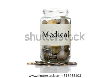 """Medical"" text label on full coins of jar spill out from it isolated on white background - saving, donation, financial, future investment and insurance concept - stock photo"