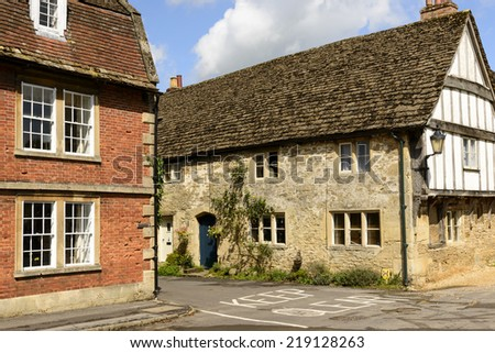 medieval houses , Lacock detail of medieval cottages built in brick, stone and wattle, prospecting on a street in historic touristic village of  Wiltshire  - stock photo