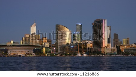 - Melbourne at dusk; view towards Docklands; company logos were removed; Melbourne, Victoria, Australia - stock photo