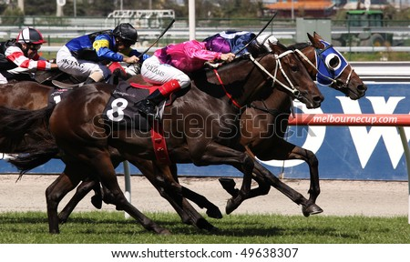 MELBOURNE - MARCH 13: Horses race to the finish of the Roy Higgins Quality, won by Elmore at Flemington on March 13, 2010 - Melbourne, Australia. - stock photo