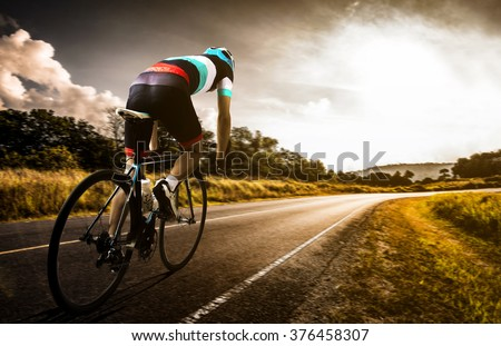 Men cycling road bike in the morning - stock photo