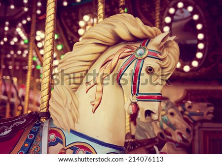 merry-go-round wooden horses toned with a retro vintage instagram filter effect  - stock photo
