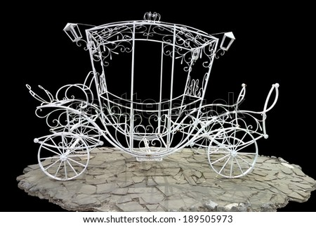 Metal brougham  without horses on a black background.                              - stock photo