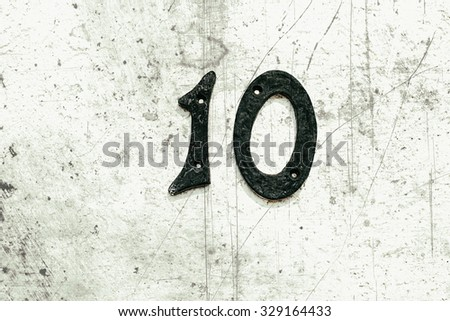 metal numbers with screw heads - stock photo