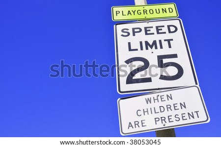 25 mile and hour sign against blue sky room for copy space - stock photo