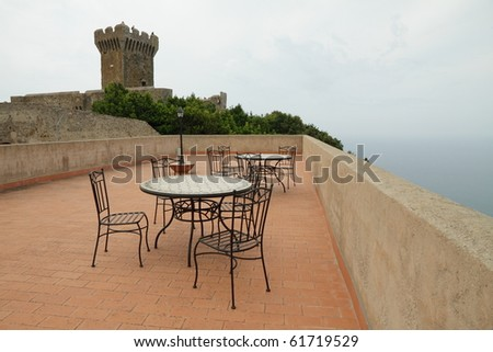 mist over  terrace with view of sea and castle, Italy - stock photo