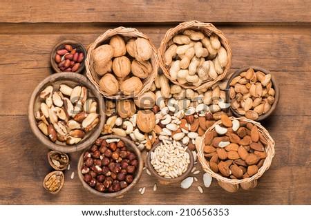 mixed nuts - hazelnuts, walnuts, almonds, pine nuts, brazil, cashew, pistachios, peanuts  - stock photo