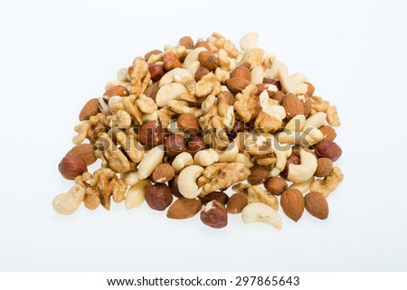mixed nuts  -  hazelnuts, walnuts, cashews,  pine nuts isolated on white background - stock photo