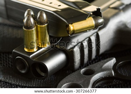 9mm ammunition and military special ops handgun with spare magazine and tactical knife - stock photo
