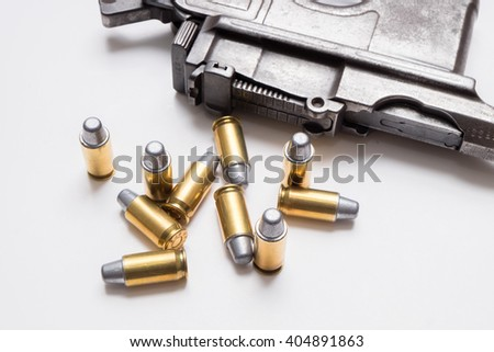 .45mm bullet with gun isolated on white background. - stock photo