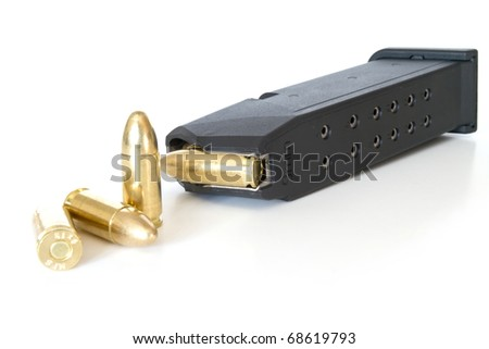 9mm bullets and magazine isolated on white - stock photo