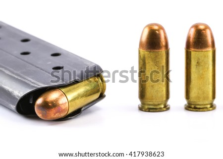 11mm bullets for a short gun. bullets isolated on white background. - stock photo