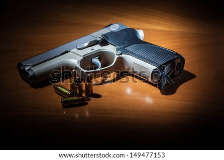 9mm hand gun with rounds - stock photo