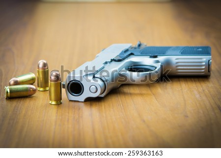 .380 mm hand gun with rounds - stock photo