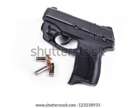 9mm Handgun isolated with four bullets. - stock photo