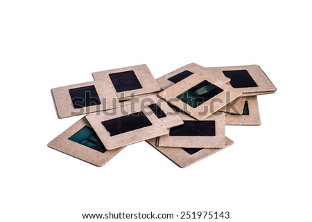 35 mm mounted film slides into the cardboard different colored isolated on white background, clipping path embedded - stock photo
