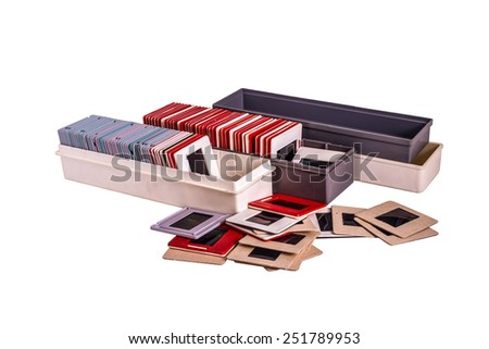 35 mm mounted film slides into the plastic and cardboard different colored frames and plastic boxes isolated on white background, clipping path embedded - stock photo