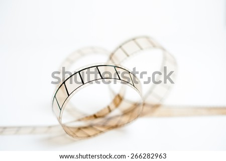 35mm movie film bow closeup on white background, selective focus - stock photo