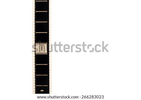 35mm movie film with number one frame countdown, vertical and copyspace isolated on white background - stock photo