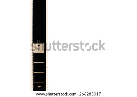 35mm movie film with number three frame countdown, vertical and copyspace isolated on white background - stock photo
