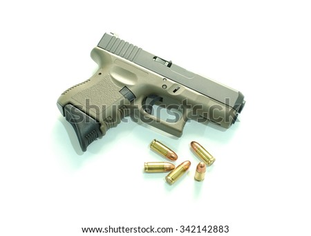 9 mm pistol and cartridges - stock photo