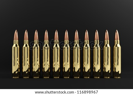 5.56 mm rifle bullets organizing in row. - stock photo