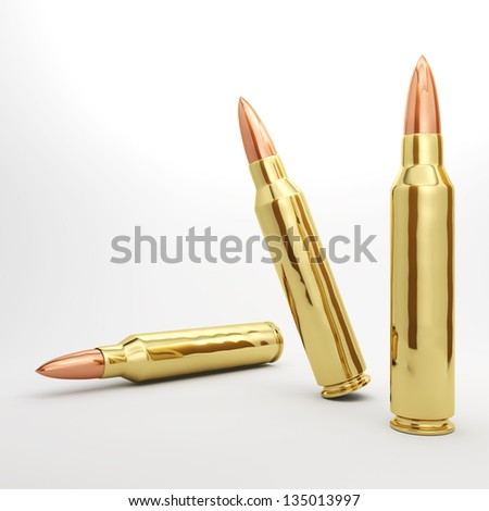 3 5.56mm rifle bullets spread out. - stock photo