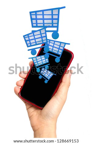 mobile phone in hand and shopping symbols - stock photo