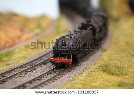Model trains in an unfinished miniature goods yard - stock photo
