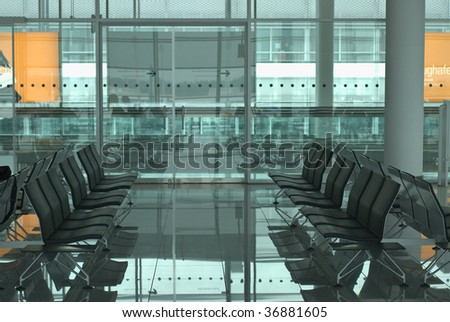 Modern Airport Waiting Room with Chairs - stock photo