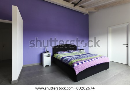 modern architecture contemporary,  interior, bedroom with purple wall - stock photo
