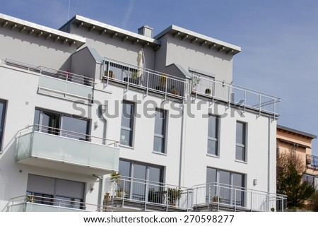 Modern dwelling houses with balconies in Germany - stock photo