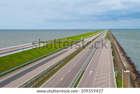 Modern Highway on the Protective Dam in Netherlands - stock photo
